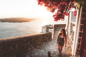 istock Caucasian woman exploring Santorini at sunset 1282216049