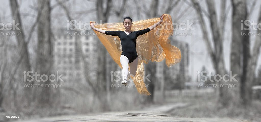 Caucasian woman floating through air with scarves royalty-free stock photo