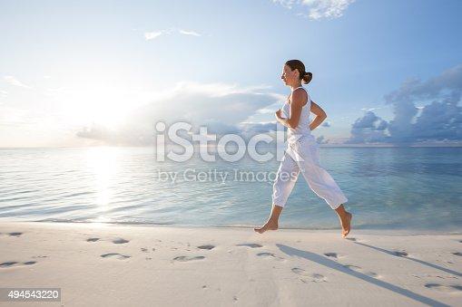638628530 istock photo Caucasian woman jogging at seashore 494543220