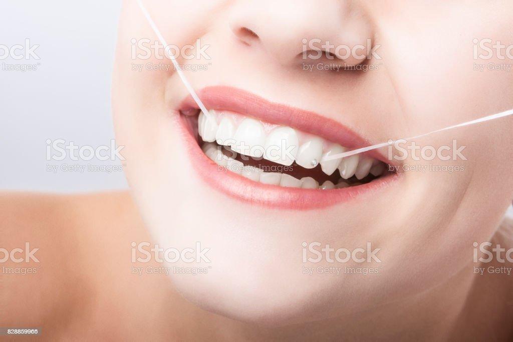 Caucasian Woman Mouth Closeup with Dental Floss. stock photo
