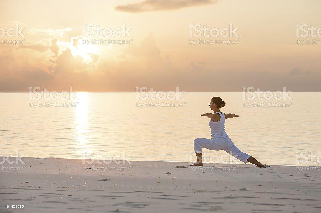 Caucasian woman practicing yoga at seashore - Royalty-free Adult Stock Photo