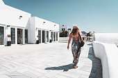 istock Caucasian woman shopping in Oia, Santorini 1280501007
