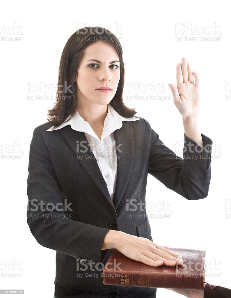 Caucasian Woman Swearing On A Bible Isolated White