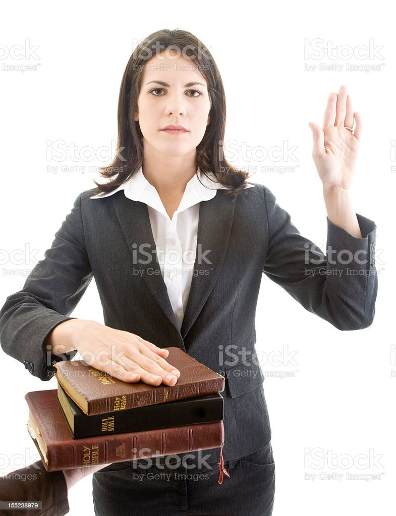 Caucasian Woman Swearing On Stack Of Bibles Isolated White