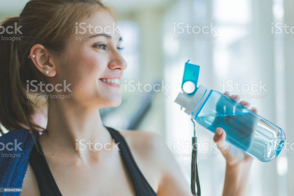 caucasian woman take a break with pure water with background of...