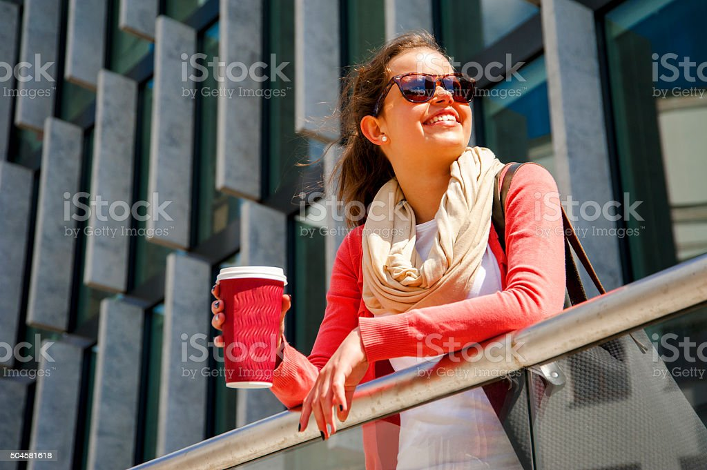 Caucasian woman Vivacious in City with a beautiful beaming smile. stock photo