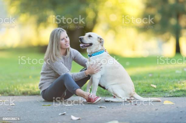 Caucasian woman walks her dog on beautiful summer evening in park picture id696508674?b=1&k=6&m=696508674&s=612x612&h=ryid6pfbg2j0ukqe8rlwahnhibe6qqm5kftugty65mq=