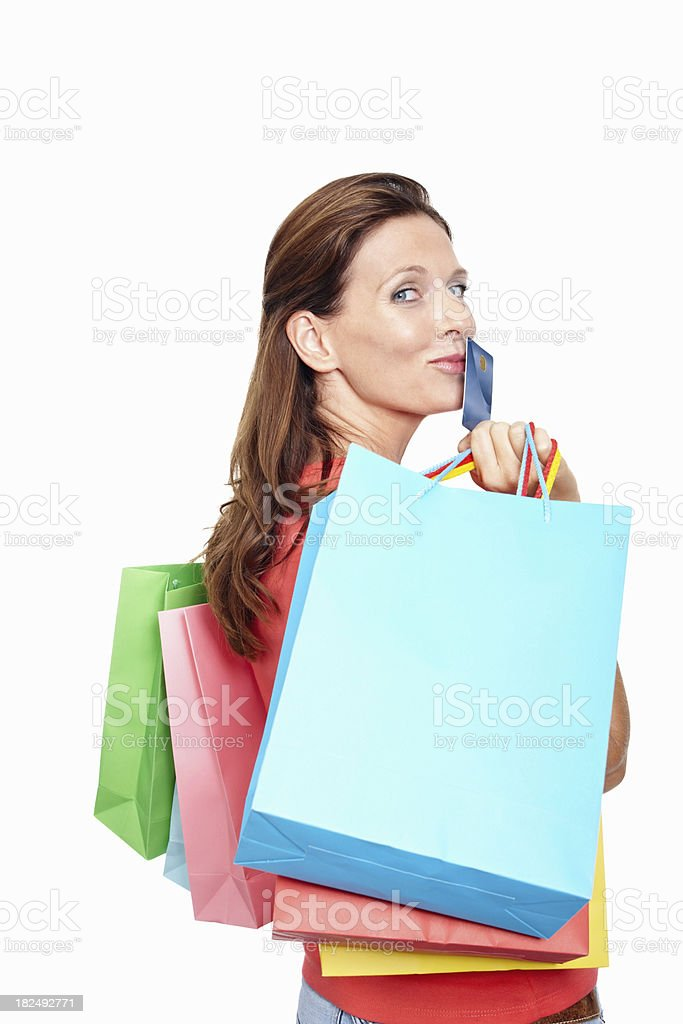 Caucasian woman with credit card and shopping bags royalty-free stock photo