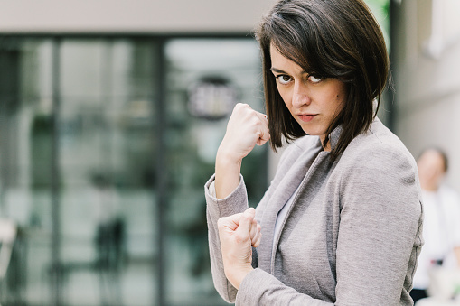 istock caucasian woman with fight concept ready to punch and protect herself business strategy ideas concept 925554534