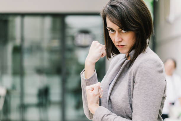 caucasian woman with fight concept ready to punch and protect herself business strategy ideas concept caucasian woman with fight concept ready to punch and protect herself business strategy ideas concept self defense stock pictures, royalty-free photos & images