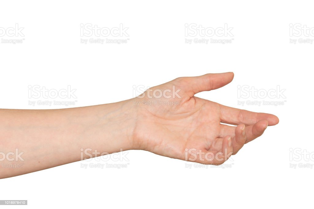 Caucasian woman's hand in outstretched helpful caring gesture. Isolated. Caucasian woman's hand outstretched in a helping hand, caring gesture. Isolated on white. A Helping Hand Stock Photo