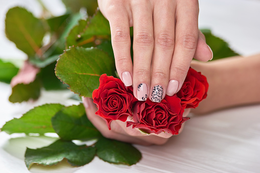istock Caucasian womans hand with manicure. 979611036