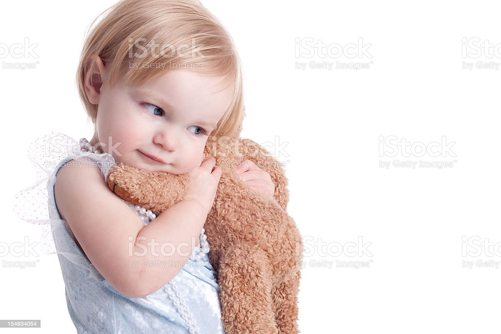 Caucasian young child cuddling a soft toy  stock photo