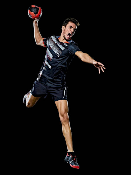 caucasian young handball player man isolated black background stock photo
