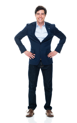 931173966 istock photo Caucasian young male business person standing in front of white background wearing jeans 1225048757