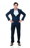 istock Caucasian young male business person standing in front of white background wearing jeans 1225048757
