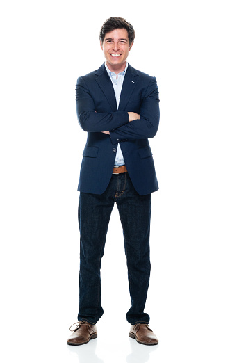 931173966 istock photo Caucasian young male business person standing in front of white background wearing jeans 1225048850