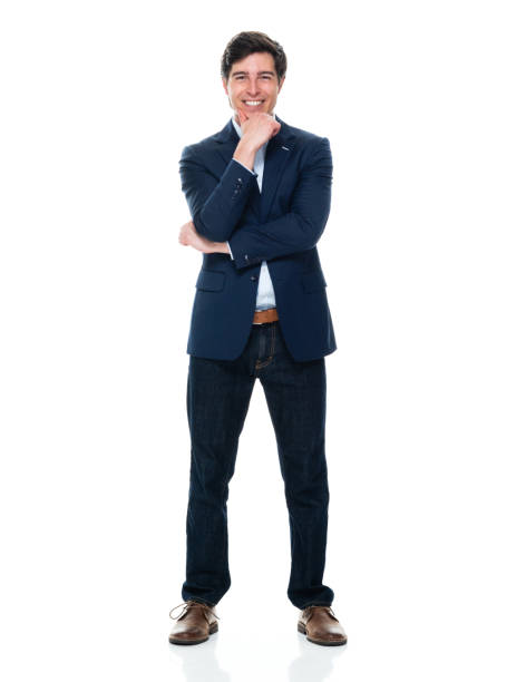 Caucasian young male business person standing in front of white background wearing button down shirt stock photo