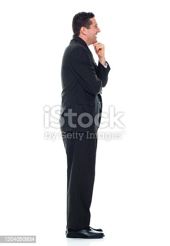 Side view of caucasian young male businessman standing wearing businesswear who is asking