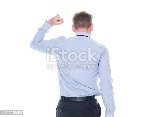 Rear view of aged 20-29 years old caucasian young male manager in front of white background who is successful who is and doing fist pump