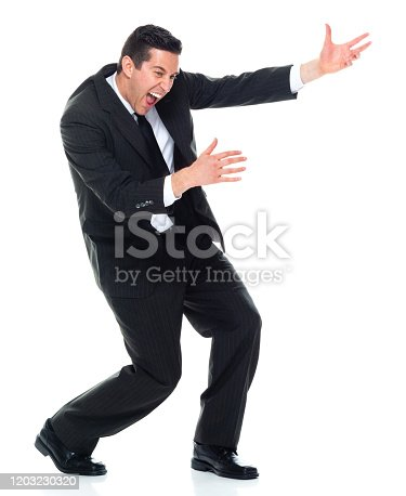 Front view of caucasian young male rock musician bending wearing businesswear who is imagination and celebrating who is doing air guitar and holding guitar