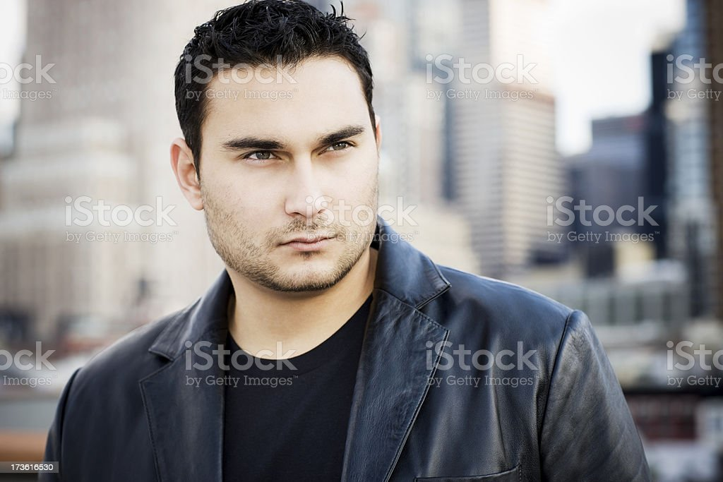 Caucasian Young Man Portrait on City Rooftop Outside, Copy Space stock photo