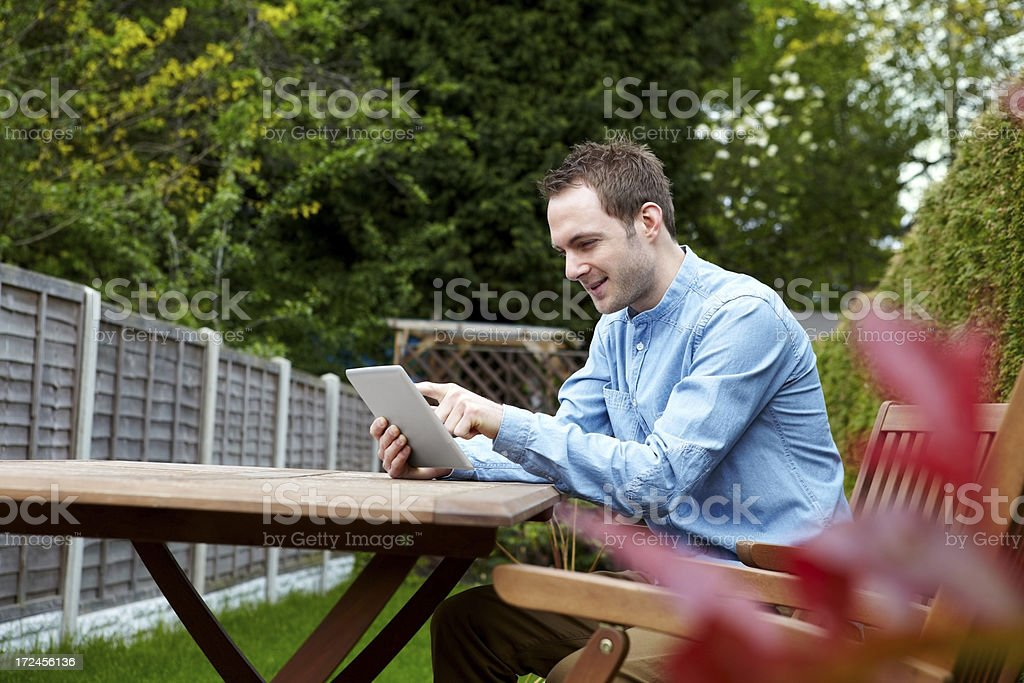 Caucasian young man surfing internet on tablet PC royalty-free stock photo