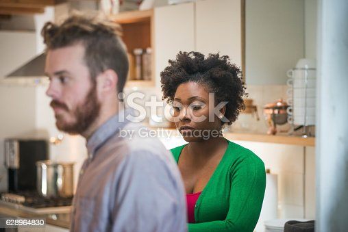 istock Caucasion Man With His African Girlfriend Looking Pensive 628964830