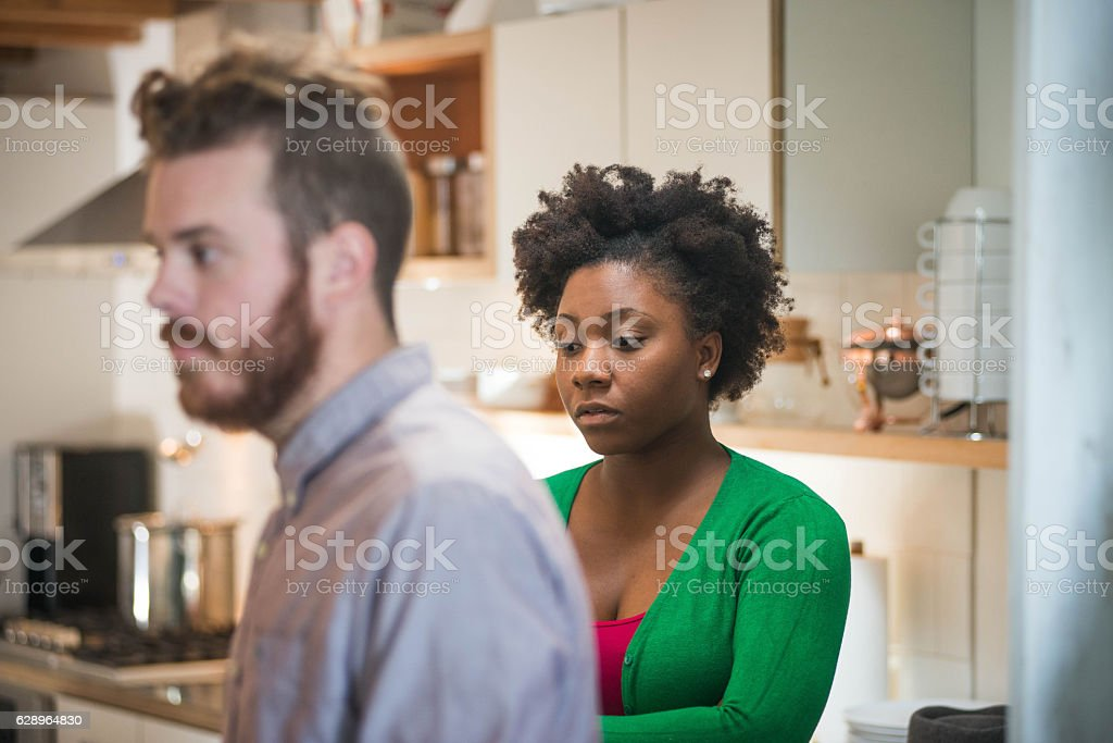 Caucasion Man With His African Girlfriend Looking Pensive stock photo
