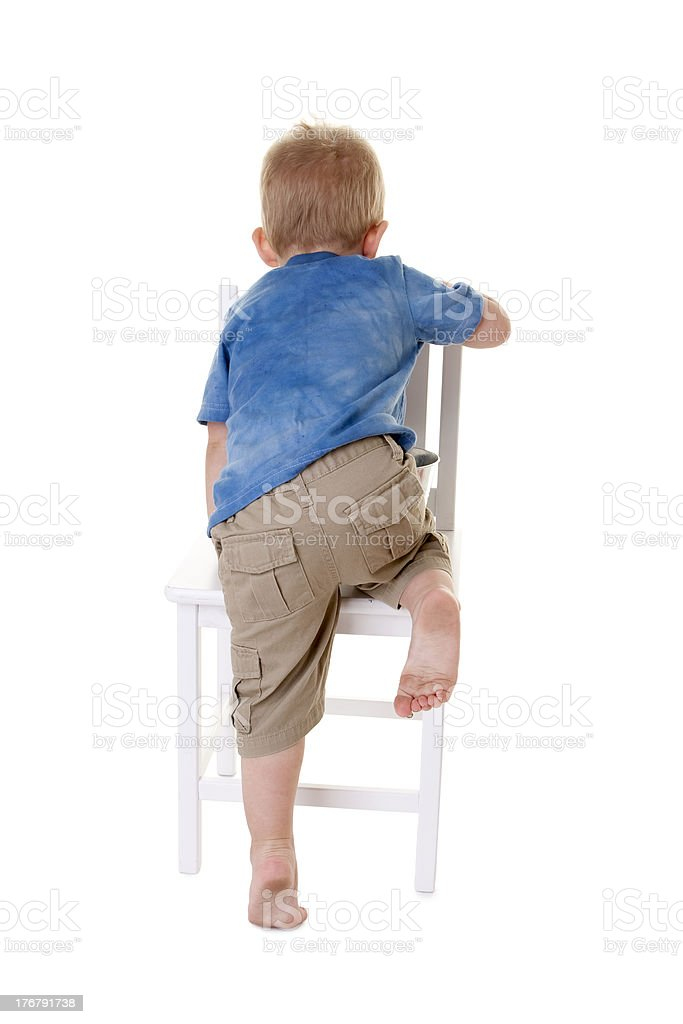 Caucasion Toddler Boy Climbing on a Chair royalty-free stock photo