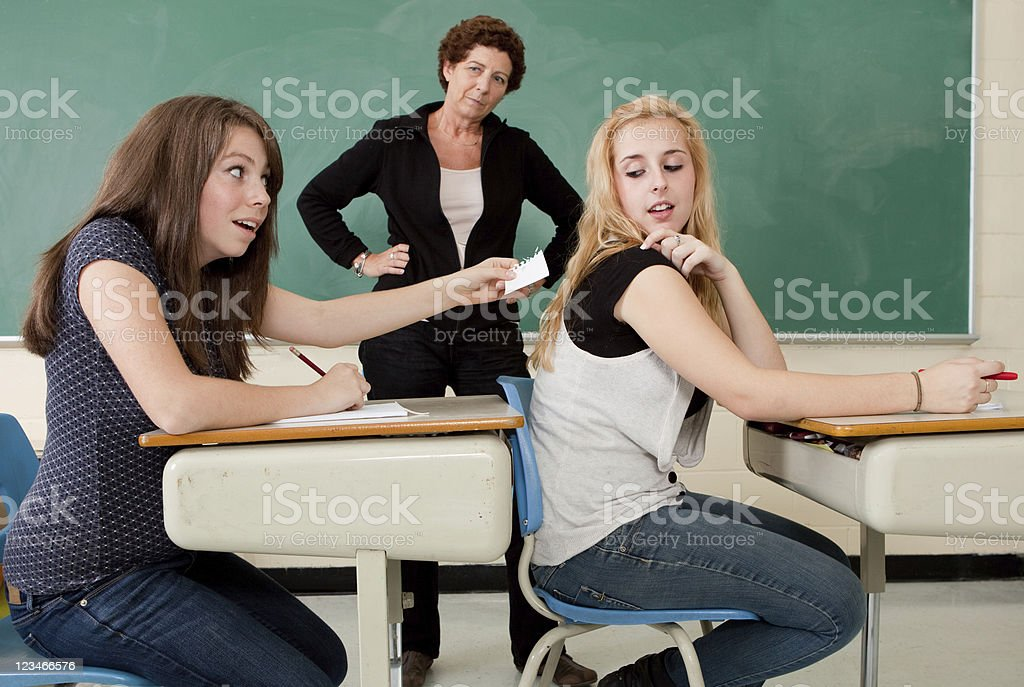 Caught cheating on an exam royalty-free stock photo
