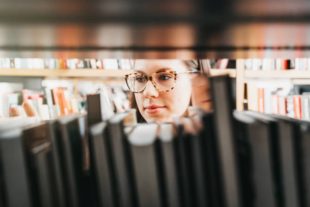 Caught looking at the books stock photo