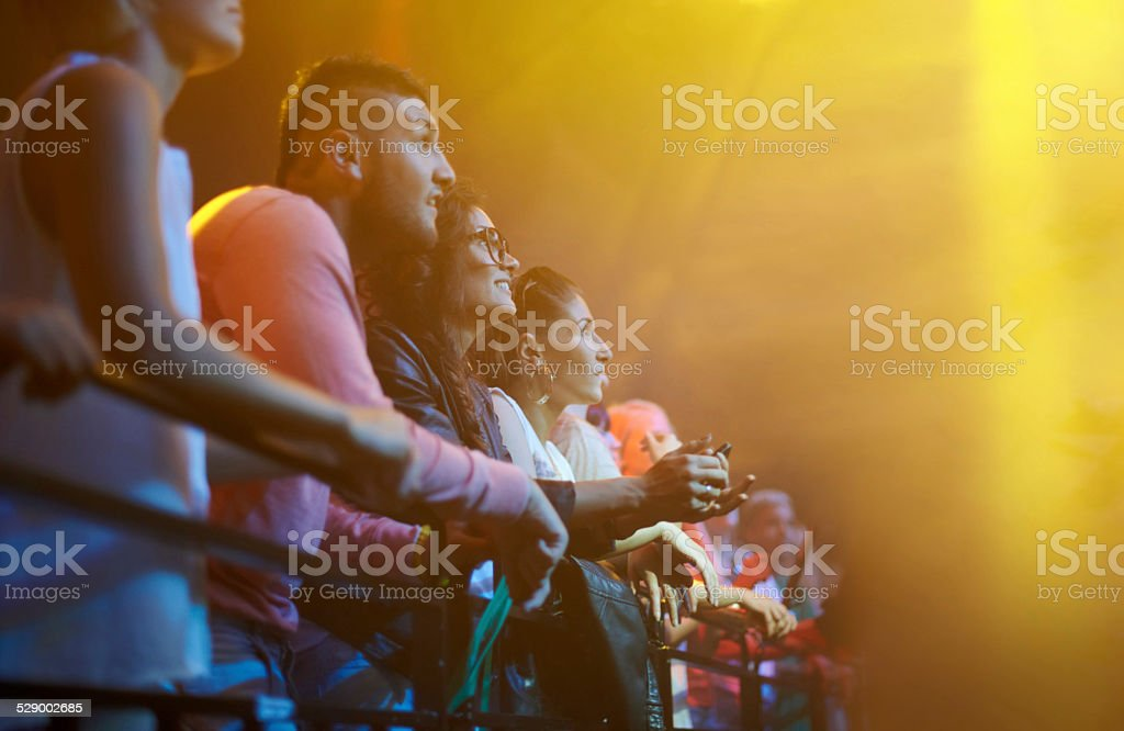 Caught up in the concert atmosphere stock photo