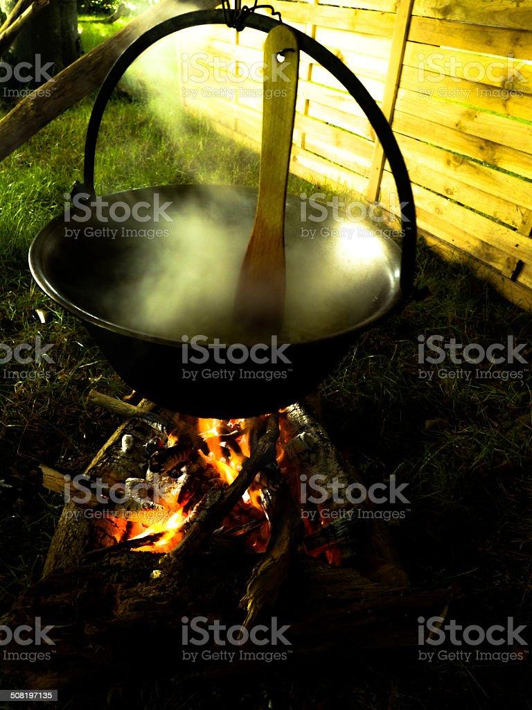 Cauldron cooking stock photo