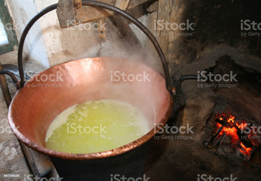 cauldron to heat whey for cheese production in a dairy  in the m stock photo
