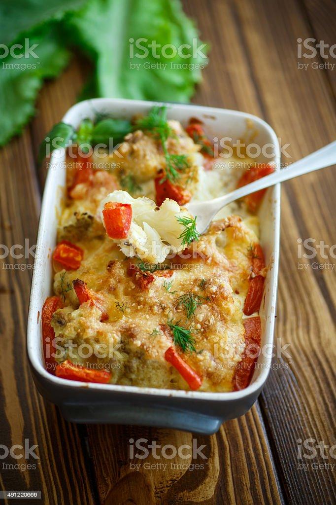 Cauliflower baked with  tomatoes stock photo