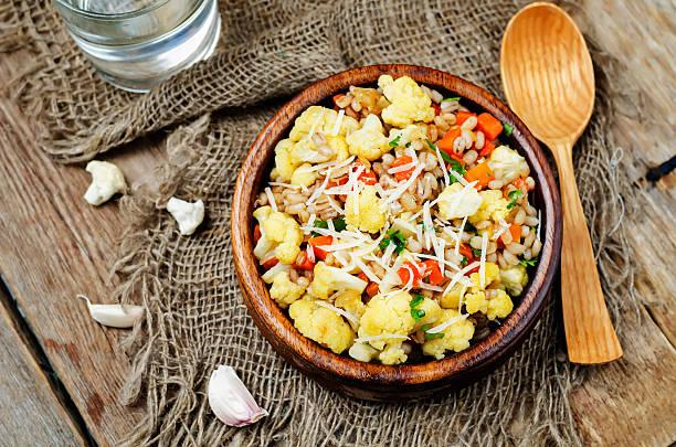 cauliflower carrot barley porridge stock photo