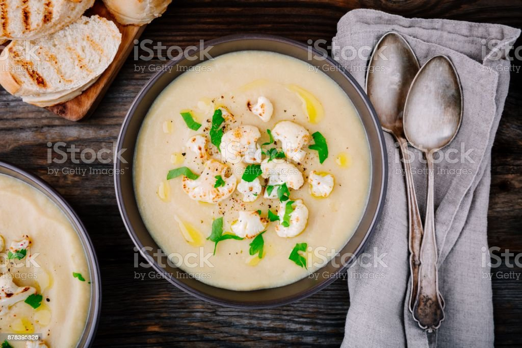 cauliflower cream soup with fried cauliflower and toasts stock photo
