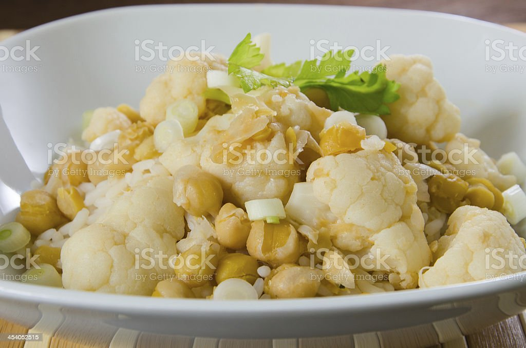 Cauliflower curry with chickpeas and spring onions royalty-free stock photo