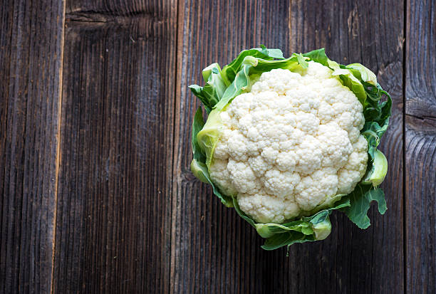 Cauliflower on wooden background stock photo