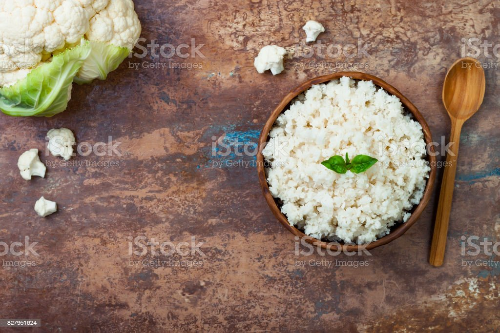 Cauliflower rice in a bowl. Top view, overhead, copy space stock photo