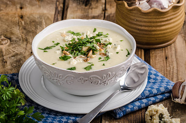 Cauliflower soup with blue cheese stock photo