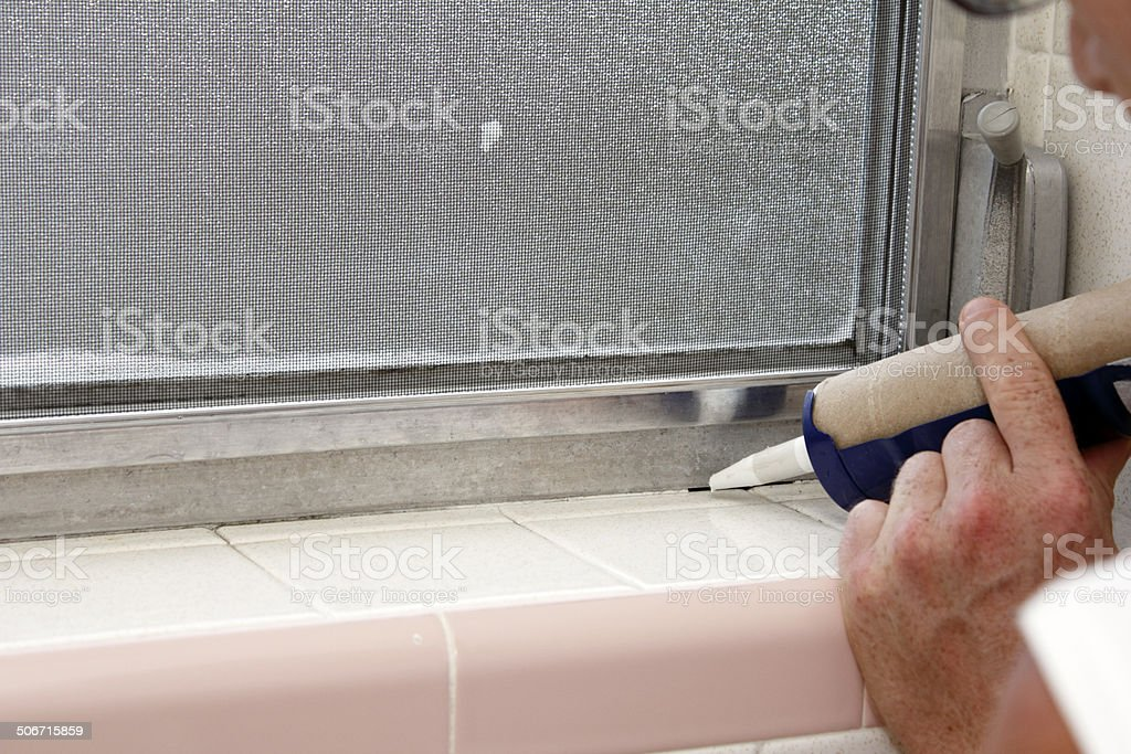 Caulking a Bathroom Window Frame stock photo