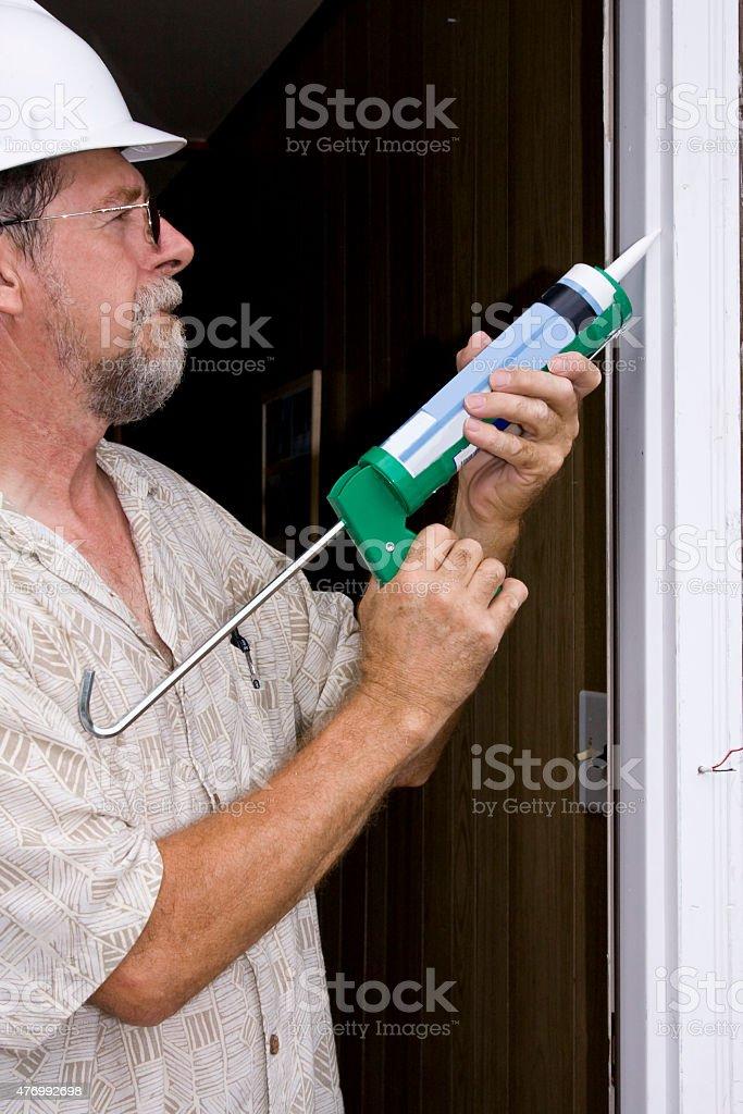 caulking doors stock photo