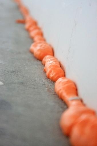 Caulking Drywall Corner - Orange Caulk Sealant on Sheetrock