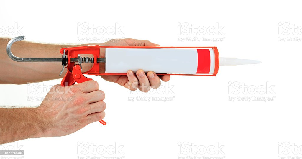 caulking gun stock photo