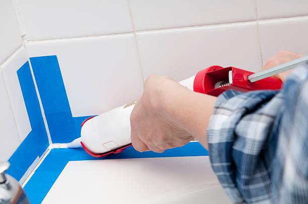 Caulking the Bathroom stock photo