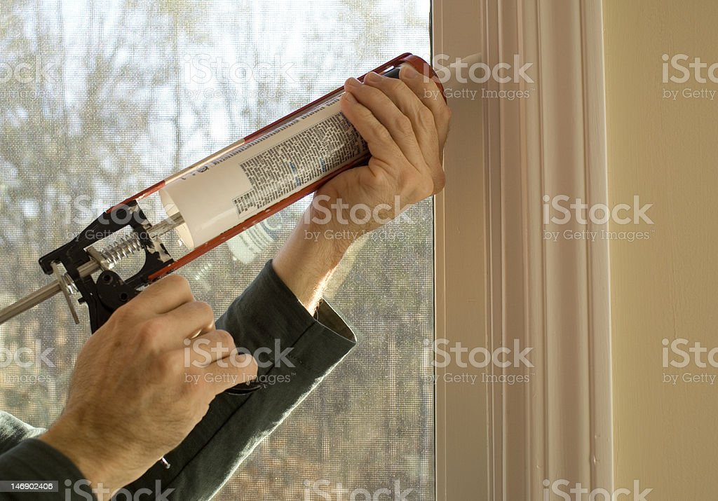 Caulking window stock photo
