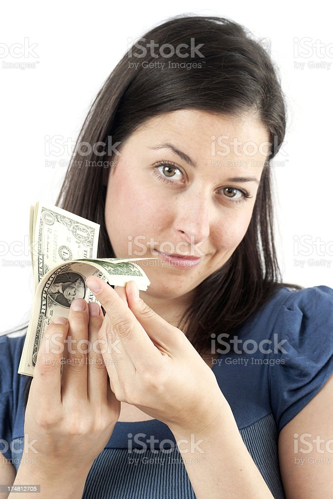 causacian girl is counting money dollary stock photo