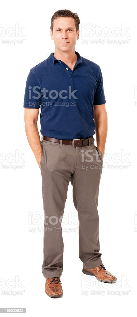 Causal businessman with hands in pockets on white stock photo